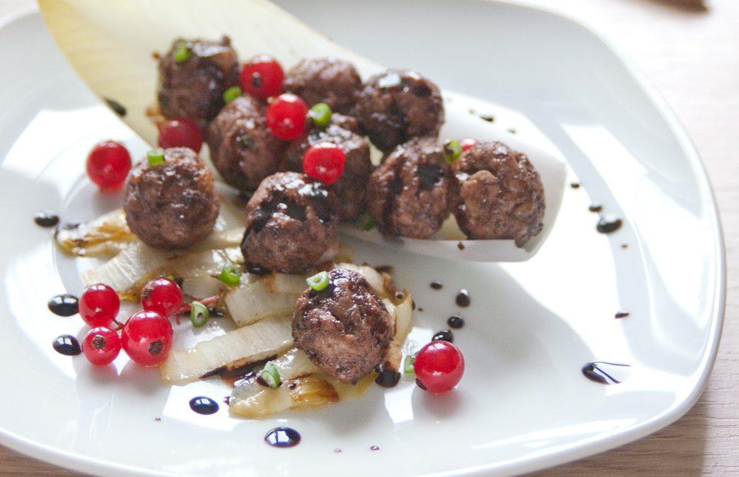 Polpette con Indivia Brasata, Ribes Rosso e  Aceto Balsamico ai Frutti di Bosco